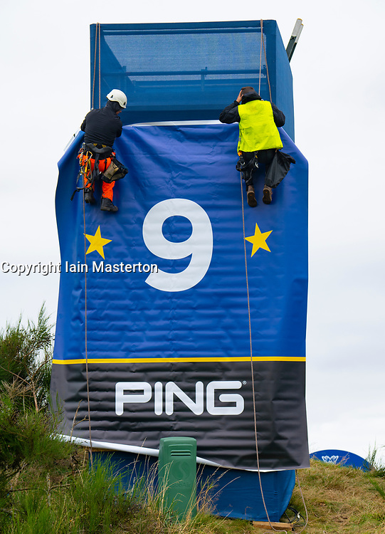 Auchterarder, Scotland, UK. 8 September 2019.  Final preparations underway at the Centenary Course at Gleneagles for the 2019 Solheim Cup between women golfers from Europe and the USA. The event runs from 9-15 September. Pictured; workers erect large banner beside green at the 9th hole. Iain Masterton/Alamy Live News