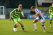 Forest Green Rover's Wade Elliott and Cheltehham Town's Jordan Lymn during the Gloucestershire Senior Cup match between Forest Green Rovers and Cheltenham Town at the New Lawn, Forest Green, United Kingdom on 20 September 2016. Photo by Shane Healey.