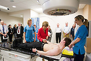 Tuesday 17th February, 2015, Aberdeen, Scotland. First Minister Nicola Sturgeon opens the new &pound;13.6 million Radiotherapy Department at Aberdeen Royal Infirmary.<br /> <br /> Pictured: L-R Cindy McIntosh, Radiographer, First Minister Nicola Sturgeon and Jenny MacBeat, Senior Therapy Radiographer Peter Houston who demonstrates the linear accelerator machine<br /> <br /> <br /> <br /> <br /> (Photo: Newsline Media)