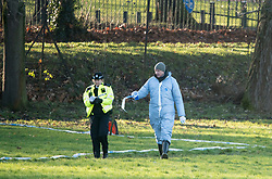 © Licensed to London News Pictures. 28/12/2017. London, UK. Police forensics at the scene in Finsbury Park where the body of a young woman was found on Boxing Day. A member of the public found the body of the woman, thought to be in her 20s, near the sports area in the centre of the park. Photo credit: Ben Cawthra/LNP