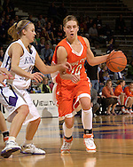Idaho State guard Joanna Hixon (R) drives up court against pressure from Kansas State's Claire Coggins (L), during the first half at Bramlage Coliseum in Manhattan, Kansas, March 17, 2006.  K-State defeated the Bengals 88-68 in the first round of the WNIT.