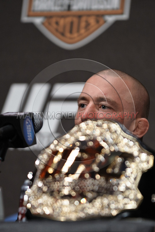 """NEW YORK, NEW YORK, MARCH 24, 2010: UFC welterweight champion Georges St. Pierre is pictured behind his title belt during the pre-fight press conference for """"UFC 111: St. Pierre vs. Hardy"""" inside Radio City Music Hall in New York City"""