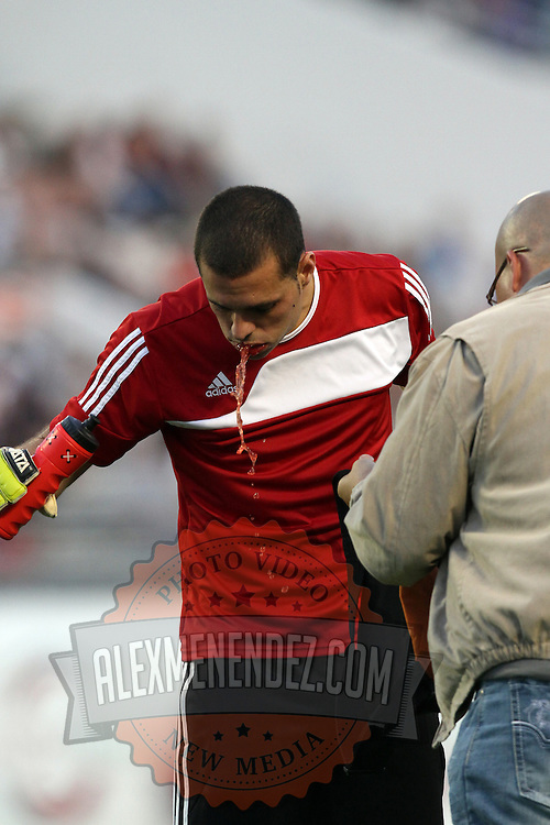 Puerto Rico United Goalkeeper Jose Miranda Boudy (14) spits out blood after getting kicked in the face during a United Soccer League Pro soccer match between Puerto Rico United and the Orlando City Lions at the Florida Citrus Bowl on April 22, 2011 in Orlando, Florida.  (AP Photo/Alex Menendez)