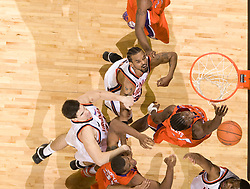 Clemson forward James Mays (40) battles with Virginia forward Adrian Joseph (30) and Virginia forward/center Ryan Pettinella (34) for a rebound.  The Virginia Cavaliers men's basketball team fell the Clemson Tigers at 82-51 the John Paul Jones Arena in Charlottesville, VA on February 7, 2008.