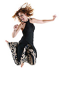 happy fashionable woman of 40 dancing On white Background