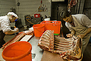 Master butcher Markus Dirr's employees hard at work at his shop in Endingen, near Freiburg im Breisgau, Germany. (Marcus Dirr is featured in the book What I Eat: Around the World in 80 Diets.) Germans are among the biggest meat eaters in Europe, but eat slightly less meat than in decades past.