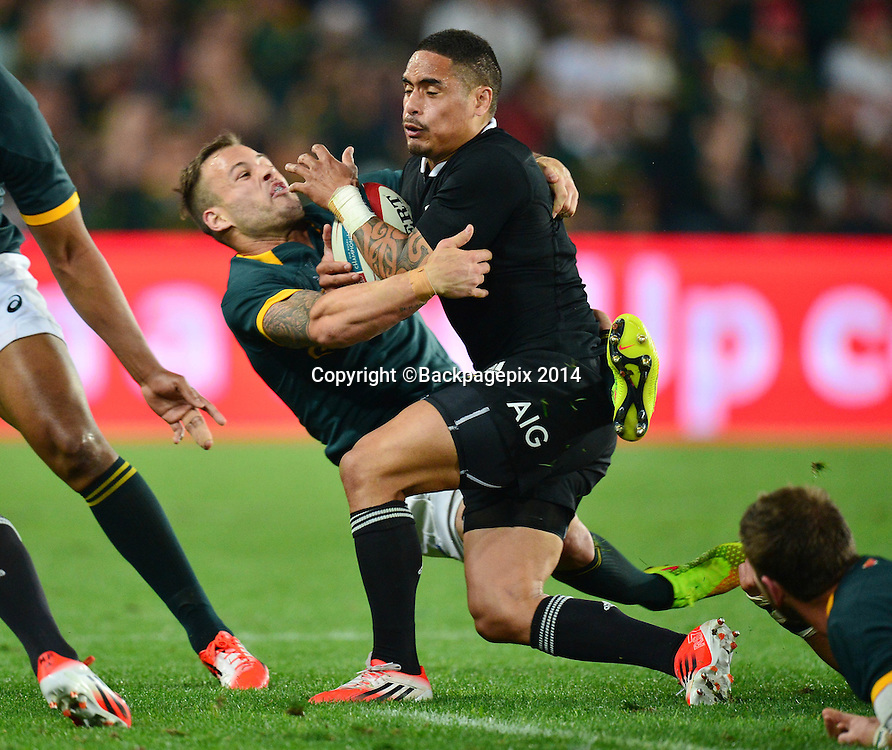 Francois Hougaard of South Africa tackles Aaron Smith of New Zealand during the Castle Lager Rugby Championship match between South Africa and New Zealand at Ellis Park on 04 October 2014 © Gavin Barker/BackpagePix