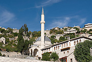 City with minaret of mosque. Pocitelj. Bosnia. Eastern Europe.