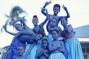 "Trinidad and Tobago ""MOKO JUMBIES: The Dancing Spirits of Trinidad"".(When it comes to the portrayal of devils in the Carnival of Trinidad, blue is the color that seems to outdo all the others. As Blue Devils, Moko Jumbies do their best to frighten their audience - and covered in blue paint they tend to look particurlary menacing in the muted light of dusk. Here they can't help but smile for this group image...).A photo essay about a stilt walking school in Cocorite, Trinidad..Dragon Glen de Souza founded the Keylemanjahro School of Art & Culture in 1986. The main purpose of the school is to keep children off the streets and away from drugs..He first taught dances like the Calypso, African dance and the jig with his former partner Cathy Ann Samuel.  Searching for other activities to engage the children in, he rediscovered the art of stilt-walking, a tradition known in West Africa as the Moko Jumbies , protectors of the villages and participants in religious ceremonies. The art was brought to Trinidad by the slave trade and soon forgotten..Today Dragon's school has over 100 members from age 4 and up..His 2 year old son Mutawakkil is probably the youngest Moko Jumbie ever. The stilts are made by Dragon and his students and can be as high as 12-15 feet. The children show their artistic talents mostly at the annual Carnival, which today is unthinkable without the presence of the Moko Jumbies. A band can have up to 80 children on stilts and they have won many of the prestigious prizes and trophies that are awarded by the National Carnival Commission. Designers like  Peter Minshall , Brian Mac Farlane and Laura Anderson Barbata create dazzling costumes for the school which are admired by thousands of  spectators. Besides stilt-walking the children learn the limbo dance, drumming, fire blowing and how to ride  unicycles..The school is situated in Cocorite, a suburb of Port of Spain, the capital of Trinidad and Tobago..all images © Stefan Falke"