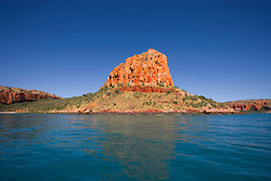 Sunlight highlights the intense colours at Raft Point at the entrance to Doubtful Bay on the Kimberley coast.
