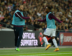 Rickie Lambert of England (Liverpool) warms up on the touchline with Saido Berahino of England (West Brom)  - Photo mandatory by-line: Alex James/JMP - Mobile: 07966 386802 - 15/11/2014 - SPORT - Football - London - Wembley - England v Slovenia - EURO 2016 Qualifier