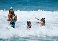 People enjoy the cold ocean water  in Hermosa Beach, California, Thursday June 15, 2017. Temperatures are expected to climb 12 to 18 degrees above normal this weekend through at least the middle of next week, according to the National Weather Service.(Photo by Ringo Chiu)<br /> <br /> Usage Notes: This content is intended for editorial use only. For other uses, additional clearances may be required.