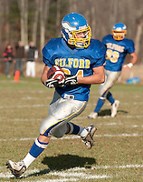 Malcom Benavides carries the ball down field during NHIAA Division VI semi final game with Newfound last Saturday.  Their win earns the Eagles their spot in the state championship game against the Newport Tigers next Saturday at the Meadows Field in Gilford.  (Karen Bobotas/for the Laconia Daily Sun)