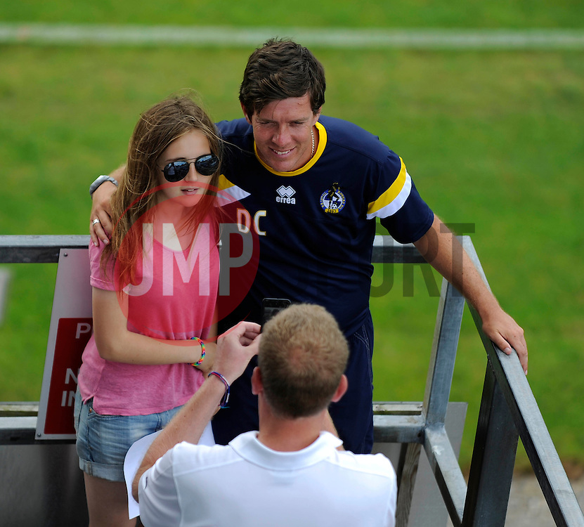 Bristol Rovers Manager, Darrell Clarke poses for a photograph with a fan - Photo mandatory by-line: Dougie Allward/JMP - Mobile: 07966 386802 27/07/2014 - SPORT - FOOTBALL - Bristol - Bristol Rovers - - Memorial Stadium - Fun Day