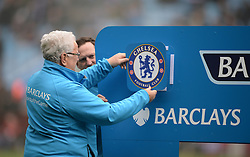 A member of the Barclays Team attaches The chelsea badge to the Barclays Sign. - Mandatory by-line: Alex James/JMP - 02/04/2016 - FOOTBALL - Villa Park - Birmingham, England - Aston Villa v Chelsea - Barclays Premier League