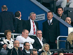 NEWCASTLE, ENGLAND - Tuesday, April 19, 2011: Manchester United's manager Alex Ferguson has to watch from the stands and avoid fans leaving early for half-time refreshments during the Premiership match at St James' Park. Ferguson is serving a five-match ban for comments made about referees. (Photo by David Rawcliffe/Propaganda)
