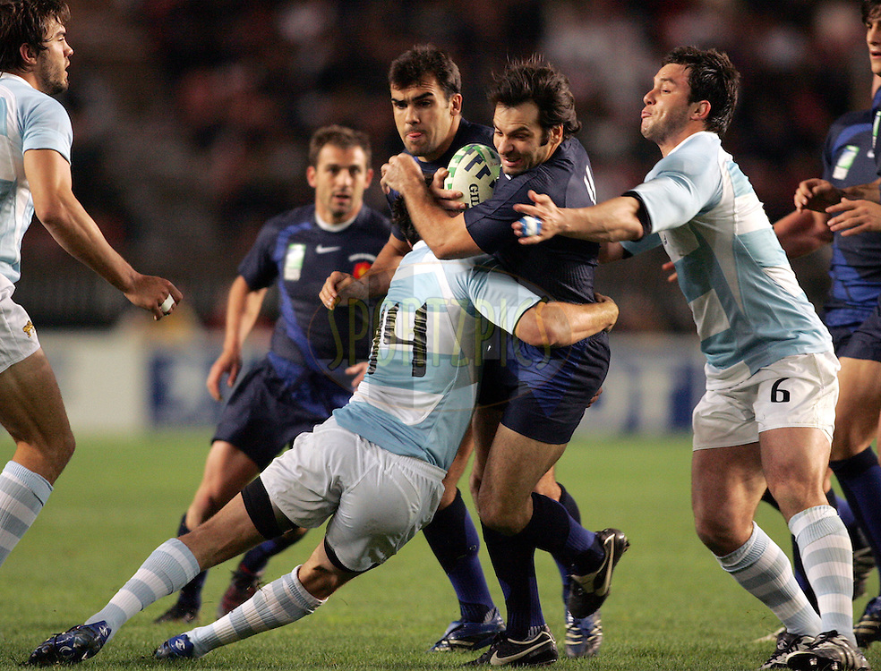 Rugby World Cup, France v Argentina, 19 October 2007. Horacio Agulla is caught in the tackle at the Parc des Princes, Paris, France. Friday 19 October 2007. Photo: Ron Gaunt/Sportzpics.net