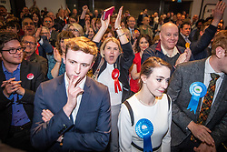 © Licensed to London News Pictures . 04/05/2018. Trafford, UK. Jubilant Labour Party supporters and two less happy Conservatives (front) at the Trafford Council count at The Point at Lancashire County Cricket Club , as the results are declared . The Labour Party are looking to overturn the Conservative Party's majority on the council . Local council elections are taking place across the country . Photo credit : Joel Goodman/LNP