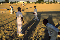 Dubai, United Arab Emirates. Boys attend a cricket camp in the desert