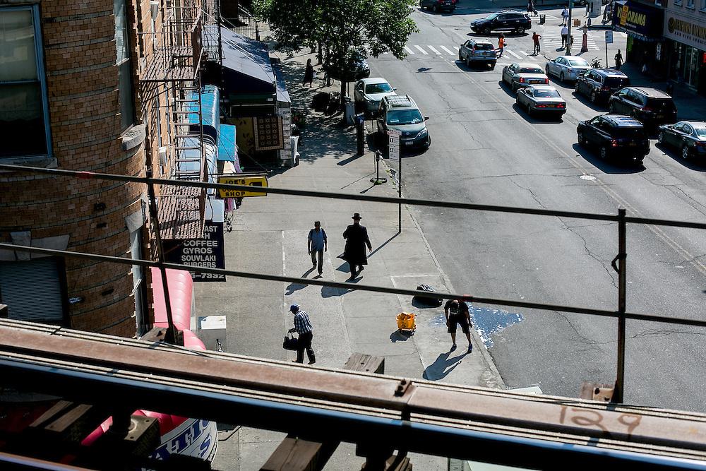 BROOKLYN, NY - JUNE 6, 2016: A man walks down the street in the Borough Park neighborhood of Brooklyn, New York. CREDIT: Sam Hodgson for The New York Times.