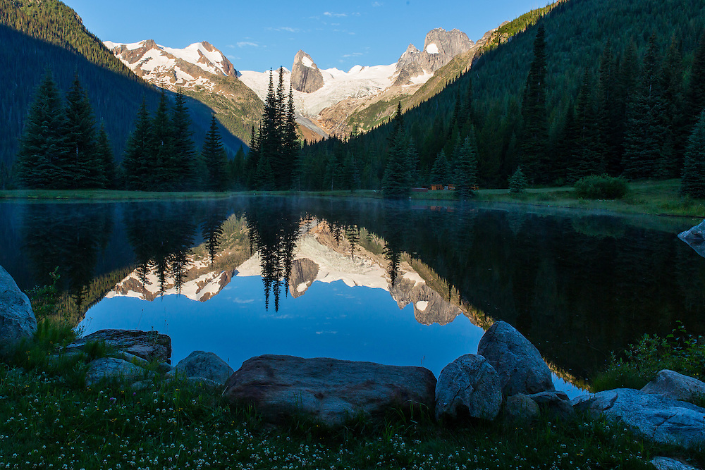 Bugaboo spires reflected in a mountain lake, Bugaboo Mountains, British Columbia, Canada