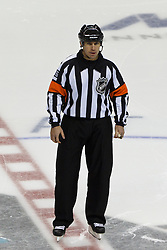 Dec 1, 2011; San Jose, CA, USA; NHL referee Brian Pochmara (16) before a face off between the San Jose Sharks and the Montreal Canadiens during the third period at HP Pavilion.  San Jose defeated Montreal 4-3 in shootouts. Mandatory Credit: Jason O. Watson-US PRESSWIRE
