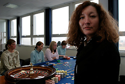 UK ENGLAND LANCASHIRE BLACKPOOL 1DEC04 - Ex-croupier Wendy Bradley poses for a photo in front of some of her students at a Roulette table at Blackpool College. As part of proactive preparation for the hoped-for arrival of the 'Super-Casinos', Blackpool College has initiated croupier courses to fill the anticipated future gap in the local labour market.....jre/Photo by Jiri Rezac....© Jiri Rezac 2004....Contact: +44 (0) 7050 110 417..Mobile:  +44 (0) 7801 337 683..Office:  +44 (0) 20 8968 9635....Email:   jiri@jirirezac.com..Web:    www.jirirezac.com....© All images Jiri Rezac 2004 - All rights reserved.