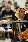 Nicor Inc. business analyst Rashesha Shah helps fill bags of food rations to be shipped to Jamaica at Feed My Starving Children in Schaumburg, Illinois on Saturday, May 21st, 2011 during Nicor's 15th Volunteer Day. The company's annual event includes volunteering at events like outdoor clean ups at local social service agencies, food sorting at area pantries and energy-saving improvements at the homes of senior citizens. For additional information, visit nicor.com or contact Richard Caragol at 630-388-2686.