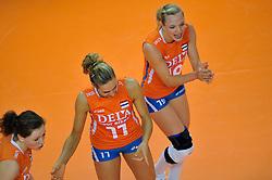 30-10-2011 VOLLEYBAL: NEDERLAND - BELGIE: ZWOLLE <br /> Nederland wint de tweede oefenwedstrijd met 3-2 van Belgie / (L-R) Lonneke Sloetjes, Caroline Wensink, Judith Pietersen<br /> ©2011-WWW.FOTOHOOGENDOORN.NL