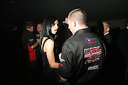 Michelle Cobb and Jamie Ingram, ( with tribute to Karl Brooks on his shirt) 3rd Annual Powerboat Rally. Blade Run Send Off Party. The Conservatory at Chelsea, Embankment. London sw3. 25 July 2007. .  -DO NOT ARCHIVE-© Copyright Photograph by Dafydd Jones. 248 Clapham Rd. London SW9 0PZ. Tel 0207 820 0771. www.dafjones.com.
