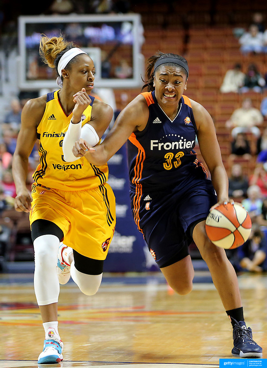 UNCASVILLE, CONNECTICUT- JUNE 5:   Morgan Tuck #33 of the Connecticut Sun drives to the basket defended by Tiffany Mitchell #3 of the Indiana Fever during the Indiana Fever Vs Connecticut Sun, WNBA regular season game at Mohegan Sun Arena on June 3, 2016 in Uncasville, Connecticut. (Photo by Tim Clayton/Corbis via Getty Images)