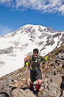 A young man hiking the Skyline Trail on Mount Rainier, Washington, USA.