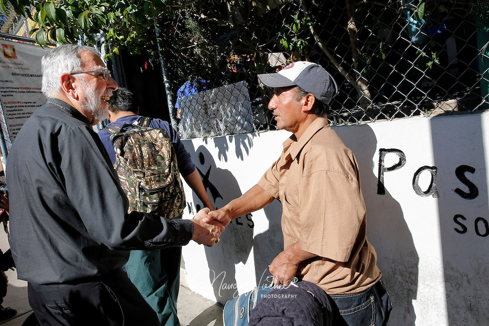 "Bishop Gerald F. Kicanas of Tucson, Ariz., greets men entering the soup kitchen of the Kino Border Initiative in Nogales, in the Mexican state of Sonora, in this 2014 photo. The bishop said he welcomed the news of the Vatican has created of the Mexican Diocese of Nogales, saying that the Tucson Diocese and are covered by Nogales Diocese have ""many common pastoral concerns."" (CNS photo/Nancy Wiechec) See NOGALES-REACT (UPDATED) March 27, 2015."