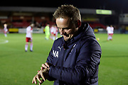 AFC Wimbledon manager Neal Ardley checking his watch during the EFL Trophy group stage match between AFC Wimbledon and Stevenage at the Cherry Red Records Stadium, Kingston, England on 6 November 2018.
