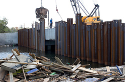 21 Sept 2005. New Orleans, Louisiana.  Hurricane Katrina aftermath. <br /> Army Corps of engineers race against time to shore up weak levee defences at the 17th street canal in New Orleans in preparation for Hurricane Rita storm surge that could once again swamp the city.<br /> Photo; ©Charlie Varley/varleypix.com