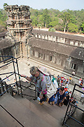 Visitors climb up the stairs within the ancient Angkor Wat temple complex in Angkor Wat Siem Reap, Cambodia.  Angkor Wat is one of UNESCO's world heritage sites. It was built in the 12th century and is Cambodia's main tourist destination.  (photo by Andrew Aitchison / In pictures via Getty Images)