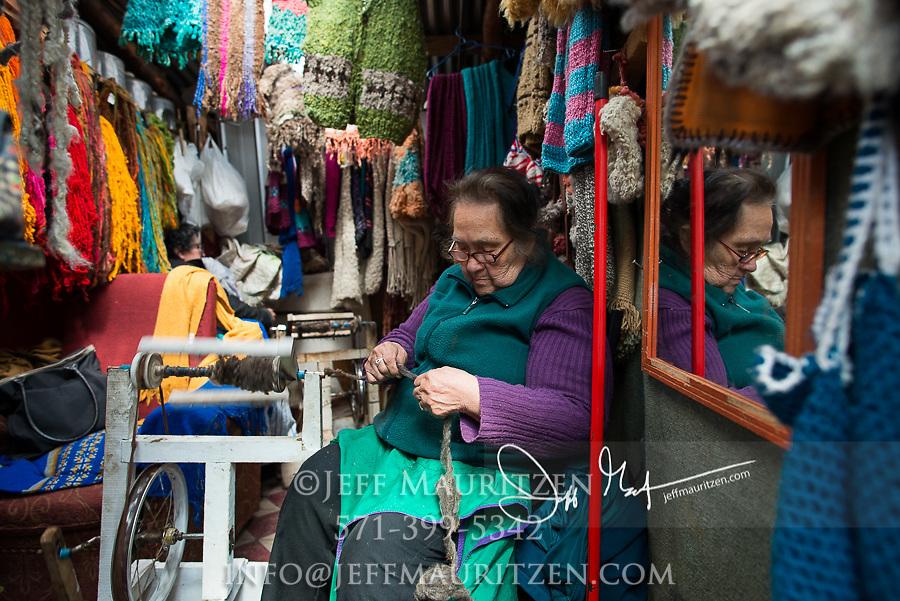 A woman spins alpaca yarn in Coyhaique, Chile.