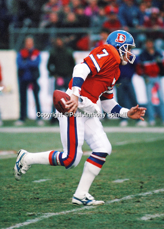 Denver Broncos quarterback John Elway (7) runs the ball during the NFL AFC Divisional playoff football game against the Pittsburgh Steelers on Jan. 7, 1990 in Denver. The Broncos won the game 24-23. (©Paul Anthony Spinelli)