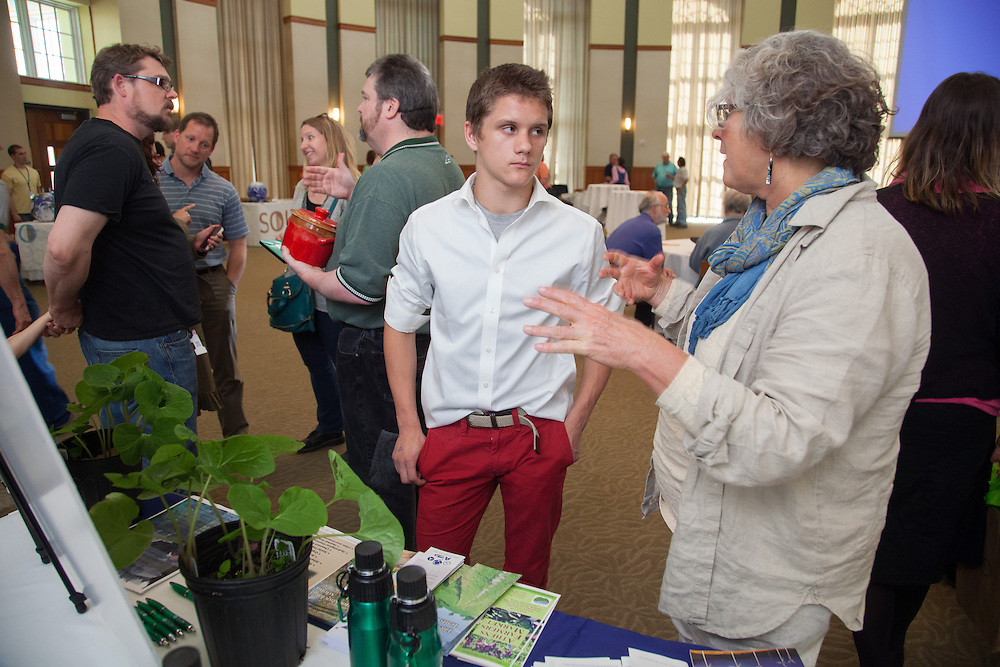 Aigaras Stuart talks with Loraine McCosker, Environment Studies advisor of the Voinovich School, during the Office of Sustainability Earth Day Reception .  Photo by Ohio University / Jonathan Adams