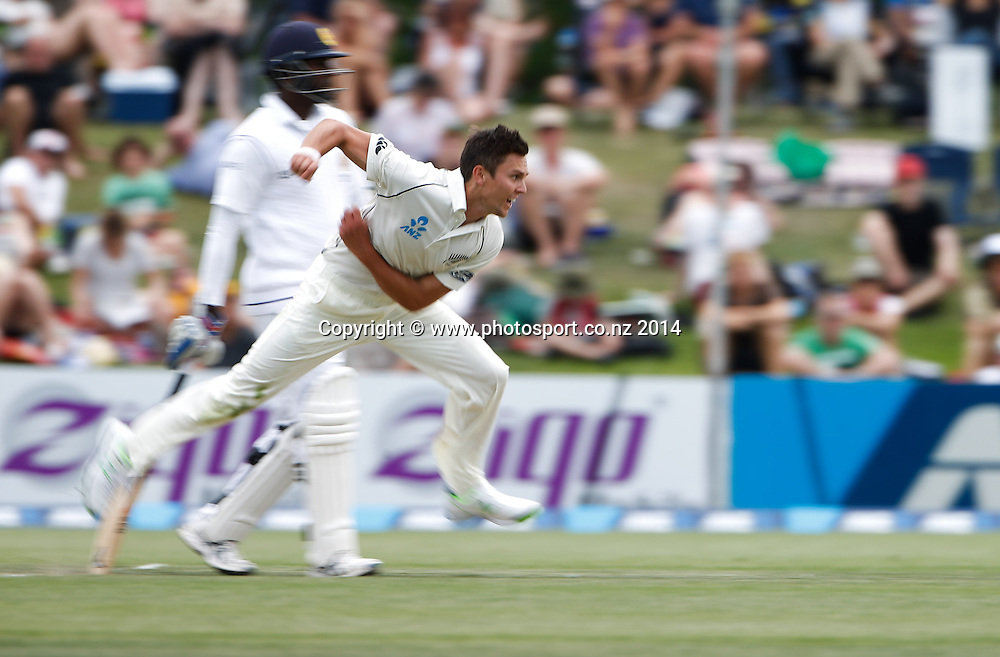 Trent Boult bowls. Day 2, ANZ Boxing Day Cricket Test, New Zealand Black Caps v Sri Lanka, 27 December 2014, Hagley Oval, Christchurch, New Zealand. Photo: John Cowpland / www.photosport.co.nz