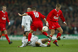 CARDIFF, WALES - Sunday, March 2, 2003: Liverpool's Michael Owen and Steven Gerrard disposses Manchester United's Ryan Giggs during the Football League Cup Final at the Millennium Stadium. (Pic by David Rawcliffe/Propaganda)