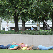 2016 U.S. Open - Day 9  Fans asleep on the grass outside Arthur Ashe Stadium on day nine of the 2016 US Open Tennis Tournament at the USTA Billie Jean King National Tennis Center on September 6, 2016 in Flushing, Queens, New York City.  (Photo by Tim Clayton/Corbis via Getty Images)