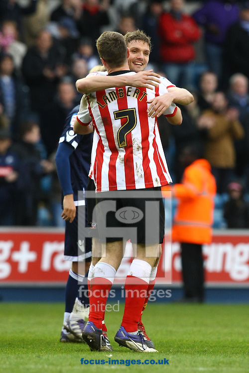 Picture by Paul Chesterton/Focus Images Ltd.  07904 640267.17/03/12.Jos Hooiveld of Southampton celebrates victory with Rickie Lambert of Southampton at the end of the Npower Championship match at The New Den Stadium, London.