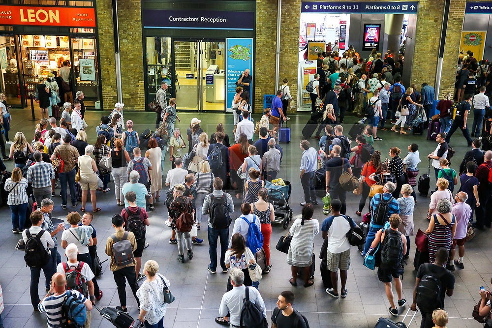© Licensed to London News Pictures. 23/08/2019. London, UK. Passengers at London's Kings Cross rail station, which is due to be closed over the August bank holiday weekend. Rail services are being affected as works can take place to replace train tracks this weekend. Photo credit: Dinendra Haria/LNP