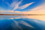 Clouds reflected in Saskatoon Lake at sunsrise<br />