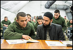 Imam Asim Hafiz  meeting Afghan Army Troops in a classroom while on a visit to Camp Qargha in Kabul, 19th January 2014 . Picture by Andrew Parsons / Parsons Media Ltd