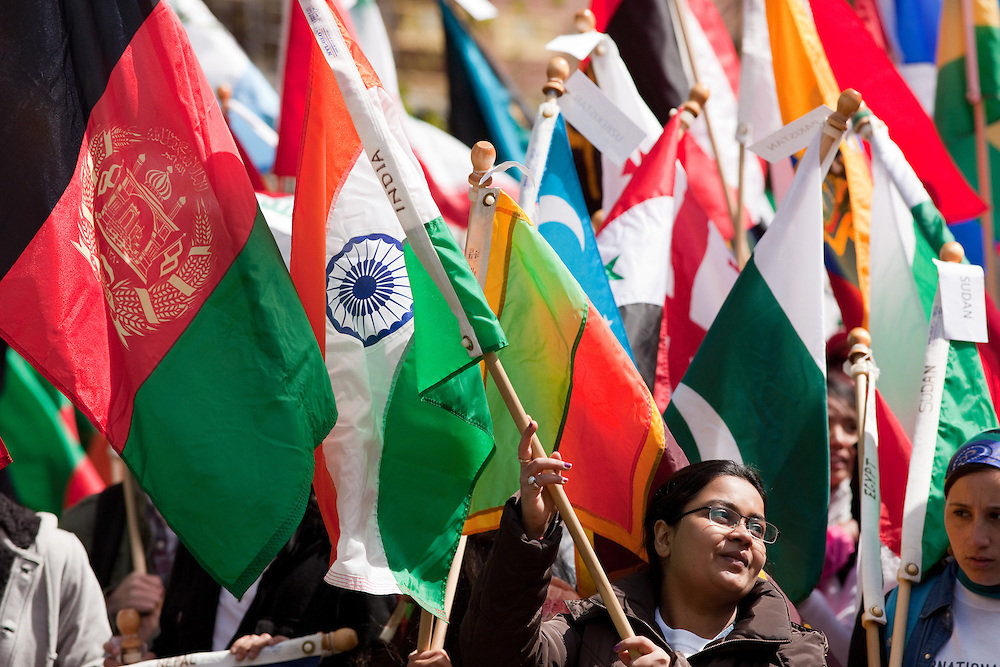 Bhakti Shah wave India's flag before the International Street Fair parade on Court Street in Athens, Ohio on Saturday, April 20, 2013. Photo by Chris Franz