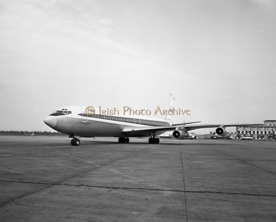 First Direct T.W.A.Flight To Dublin.    (G68), 1974, 02.05.1974..05.002.1974..2nd May 1974..Today saw the first direct trans-Atlantic, flight direct to Dublin airport from the U.S.A. T.W.A. (Trans World Airways) were the flight operators, and the aircraft, used was a Boeing, 707, registry number N799TW, Picture shows the aircraft,after landing, taxiing, to the terminal, building, at Dublin, Airport,