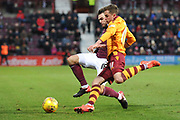 Elliot Frear under pressure from Connor Randall during the Ladbrokes Scottish Premiership match between Heart of Midlothian and Motherwell at Tynecastle, Edinburgh, Scotland on 9 December 2017. Photo by Kevin Murray.