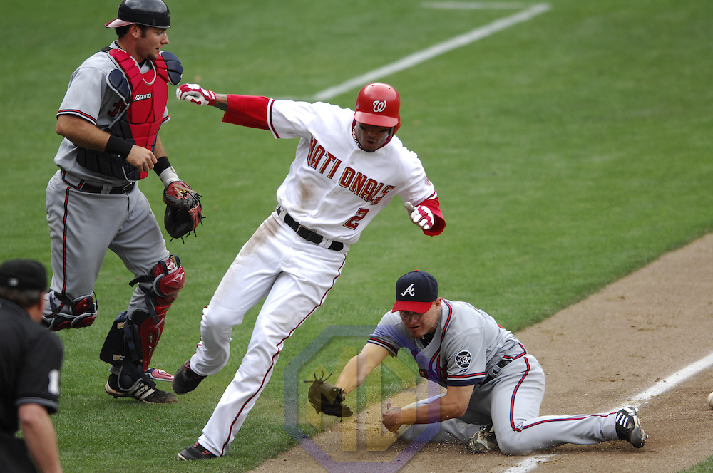 17 May 2006:   Washington Nationals shortstop Felipe Lopez (2) scores on a bases loaded single by Washington Nationals right fielder Austin Kearns as Atlanta Braves pitcher Chuck James (R) fails to handle the ball and catcher Jarrod Saltalamacchia (L) looks on in the 5th inning . The Nationals defeated the Braves 4-3 at RFK Stadium in Washington, D.C.